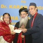 President_giving_awared_to_Dr._Karan_Singh